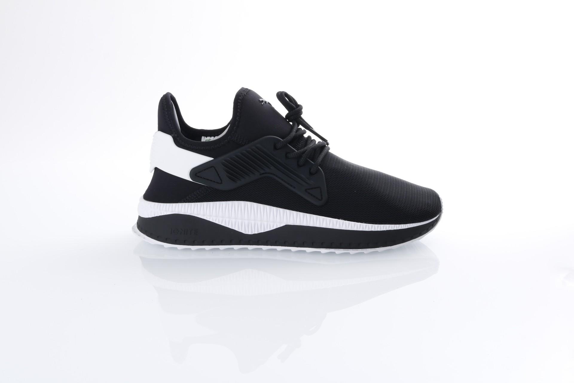 Foto van Puma 365394-01 Sneakers Tsugi cage Zwart